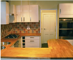 Fully fitted kitchen with wooden worktop